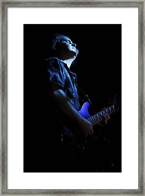 Guitarist In Blue Framed Print by Rick Berk