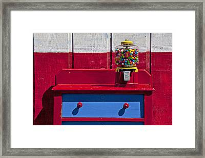 Gum Ball Machine On Red Desk Framed Print by Garry Gay