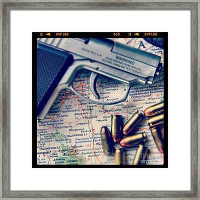 Gun And Bullets On Map Framed Print by Jill Battaglia
