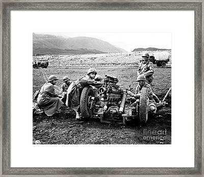 Gun Crew Prepares To Fire A 37mm Framed Print by Stocktrek Images
