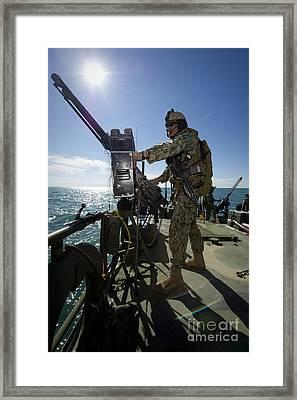 Gunner Mans A M240 Machine Gun Framed Print by Stocktrek Images