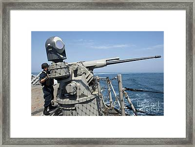 Gunners Mate Aims A 25mm Chain Gun Framed Print
