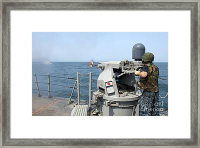 Gunners Mate Fires A 25mm Chain Gun Framed Print
