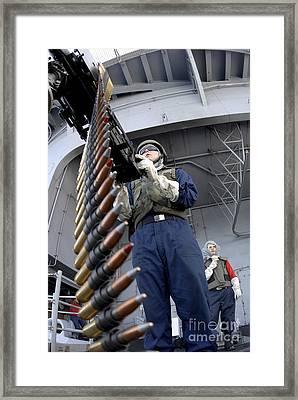 Gunners Mate Seaman Taking Aim Framed Print by Stocktrek Images