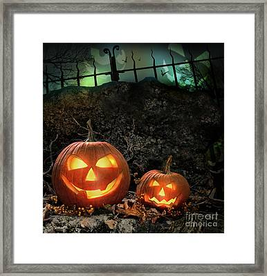 Halloween Pumpkins On Rocks  At Night Framed Print by Sandra Cunningham