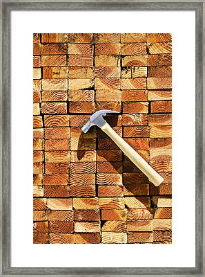 Hammer And Stack Of Lumber Framed Print
