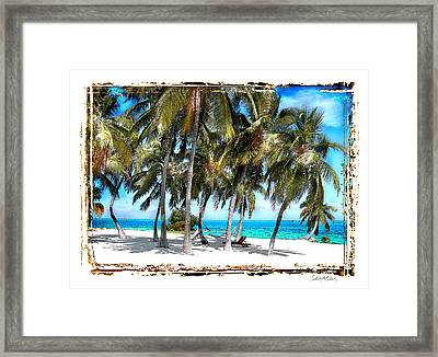 Hammock In Palms Framed Print by Linda Olsen