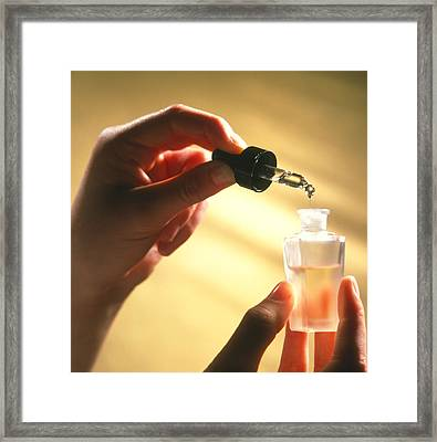 Hand Creating An Aromatherapy Oil Framed Print by Damien Lovegrove