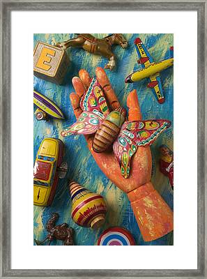 Hand Holding Butterfly Toy Framed Print by Garry Gay