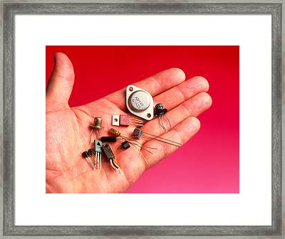 Hand Holds Transistors From The 1960s To 1990s Framed Print by Tony Craddock