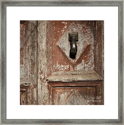 Framed Print featuring the photograph Hand Knocker And Weathered Wooden Doors by Agnieszka Kubica