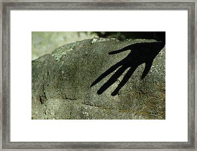 Hand On Stone Framed Print
