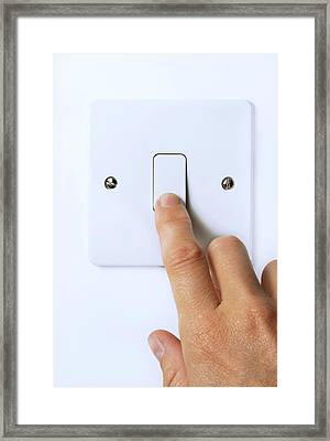 Hand Operating Light Switch Framed Print by Cordelia Molloy