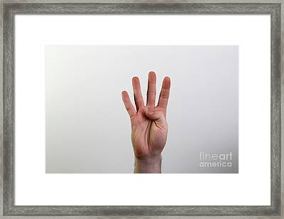 Hand Signing Number Four Framed Print by Photo Researchers, Inc.