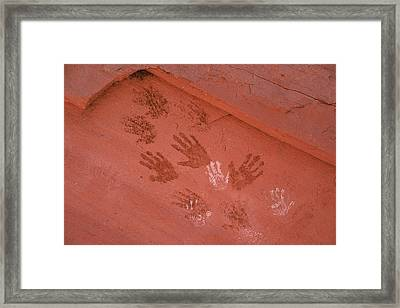Handprints Painted On A Rock Wall Framed Print by Ira Block