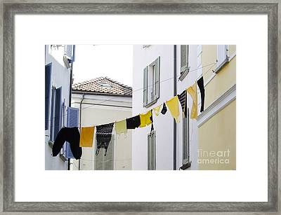 Hanging Clothes Framed Print by Mats Silvan