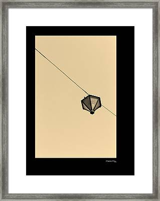 Hanging Light Framed Print by Xoanxo Cespon