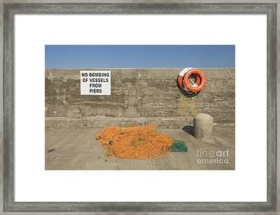 Harbor With Netting And Live Preservers Framed Print