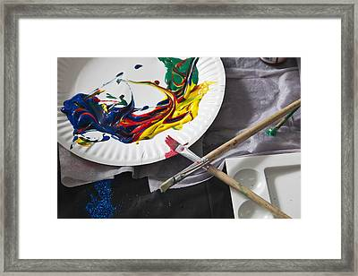 Heaps Of Acrylic Paint On A Paper Plate And Paintbrushes Framed Print by Tobias Titz