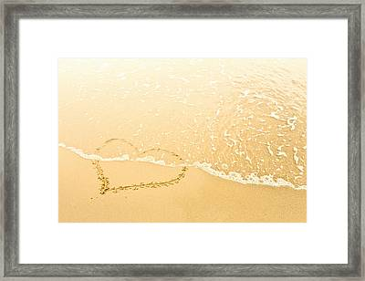 Heart In Sand Washed Away By Waves Framed Print by Dan Brownsword