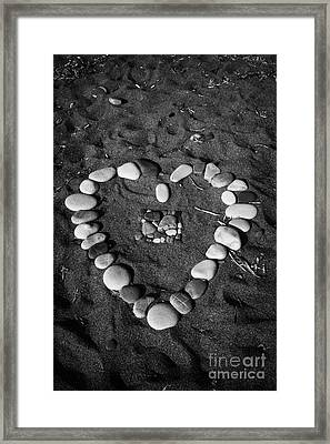 Heart Symbol Made Out Of Pebbles On The Beach At Aphrodites Rock Petra Tou Romiou Cyprus Framed Print by Joe Fox