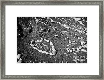 Heart Symbols Made Out Of Pebbles On The Beach At Aphrodites Rock Petra Tou Romiou Framed Print by Joe Fox