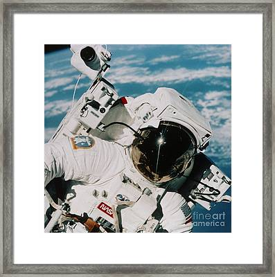 Helmet Of Astronaut Mccandless Framed Print by NASA / Science Source