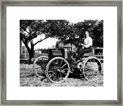Henry Ford At The Controls Of One Framed Print