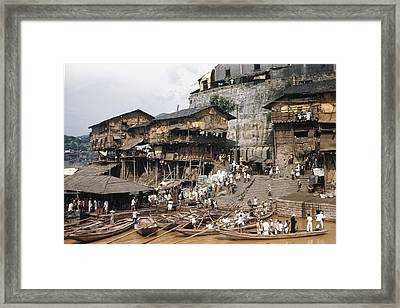 Here Many Ferry Boats Gather To Carry Framed Print