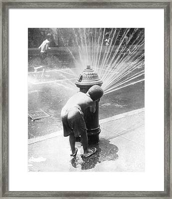 Hiding Behind Hydrant Framed Print by Archive Photos