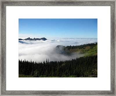 High Above The Clouds Framed Print