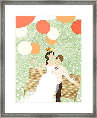 High Angle View Of Newlywed Couple Sitting On Garden Bench Framed Print by Eastnine Inc.