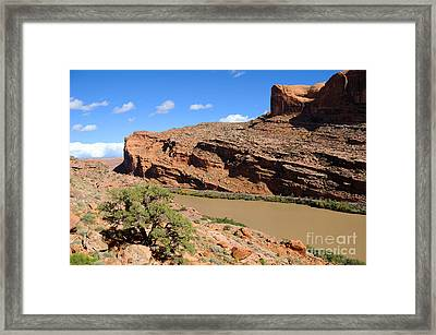Hiking The Moab Rim Framed Print by Gary Whitton