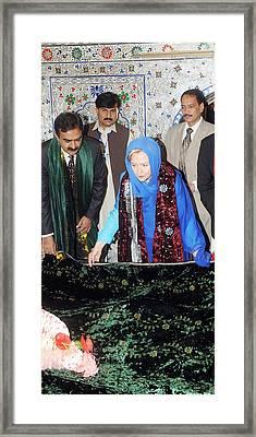 Hillary Clinton Lays A Wreath Framed Print by Everett