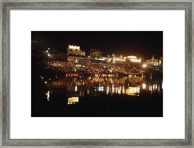 Hindus Line The Ghat At Night To Float Framed Print