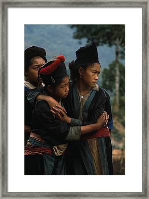 Hmong Girls Cling To Each Other Framed Print by W.E. Garrett