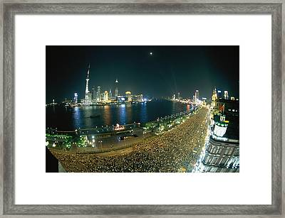 Hoards Of People Fill The Street At The Framed Print by Paul Chesley