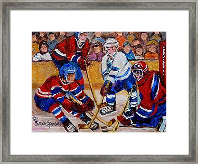 Hockey Game Scoring The Goal Framed Print by Carole Spandau