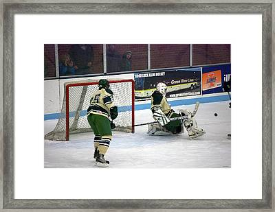 Hockey Off The Pads Framed Print by Thomas Woolworth