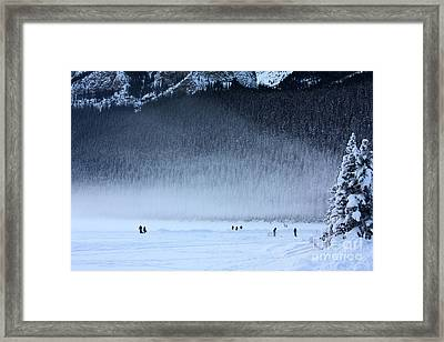 Framed Print featuring the photograph Hockey On Lake Louise by Alyce Taylor