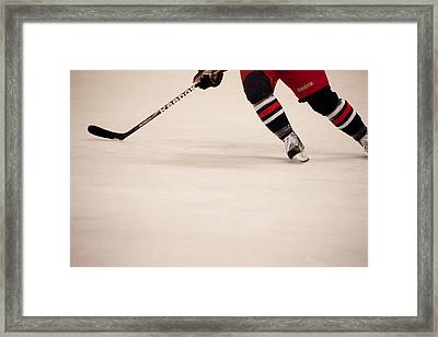 Hockey Stride Framed Print by Karol Livote