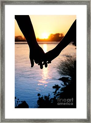 Holding Hands Silhouette Framed Print