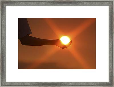 Holding The Sun Framed Print