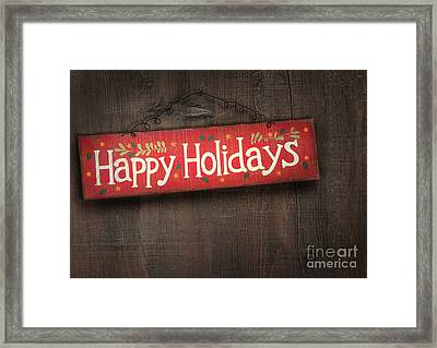 Holiday Sign On Distressed Wood Wall Framed Print by Sandra Cunningham