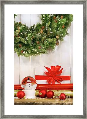 Holiday Wreath With Snow Globe  Framed Print by Sandra Cunningham