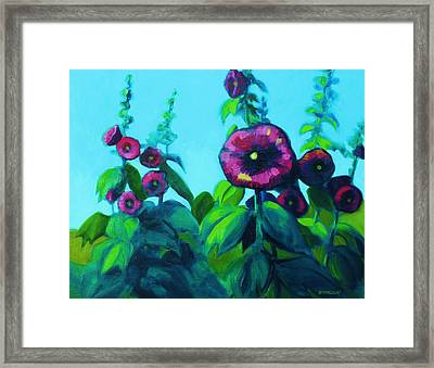 Hollyhocks Framed Print by Peggy Wrobleski