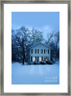 Home On A Wintery Evening Framed Print