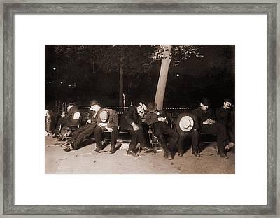 Homeless Men Sleeping On A Park Bench Framed Print