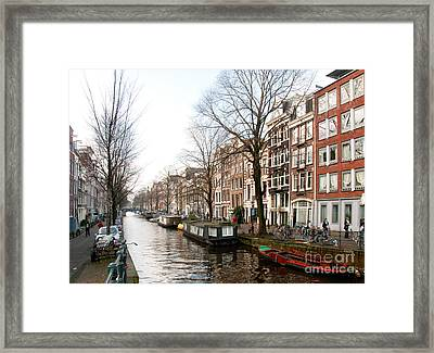 Homes Along The Canal In Amsterdam Framed Print by Carol Ailles