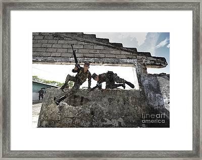 Honduran Army Soldiers Perform Building Framed Print by Stocktrek Images